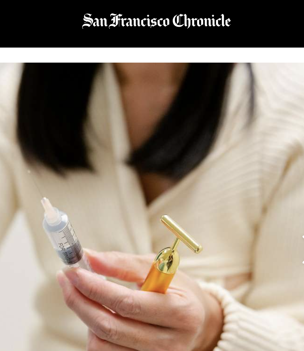San Francisco Chronicle logo and close-up of woman holding a syringe.